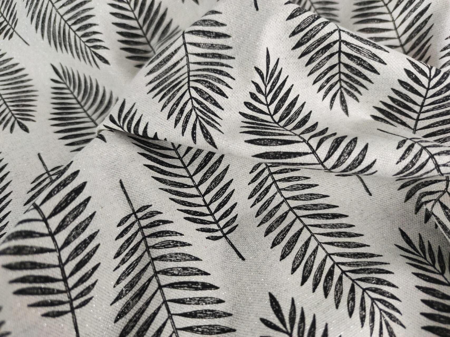 Stoffdetail-Schwarze-Blätter-Glitzer-silber-schwarz-grau